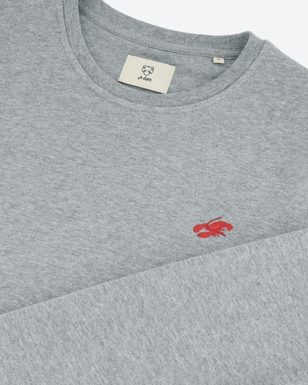 detail foto grijze sweater met logo